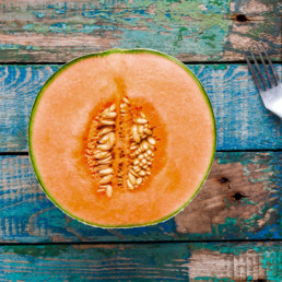Picture of half a cantaloupe on a table