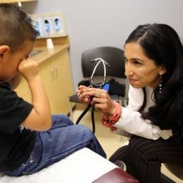 Picture Of Santa Rosa Health Center Nurse And Child